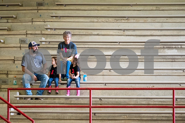 People watch the quadrille competition at Super Ride XV at Henderson County Regional Fair Park Complex in Athens, Texas, on Wednesday, June 21, 2017. The event features a variety of equestrian competitions such as trick riding and vaulting. (Chelsea Purgahn/Tyler Morning Telegraph)