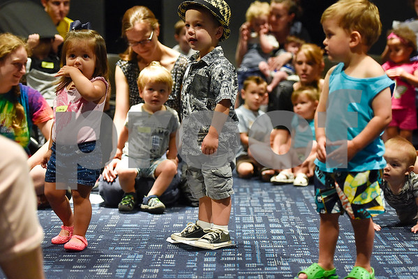 Children listen to a story during a toddlers explore class at the Tyler Public Library in Tyler, Texas, on Wednesday, June 21, 2017. The weekly event includes a story time followed by play time with a variety of toys. (Chelsea Purgahn/Tyler Morning Telegraph)