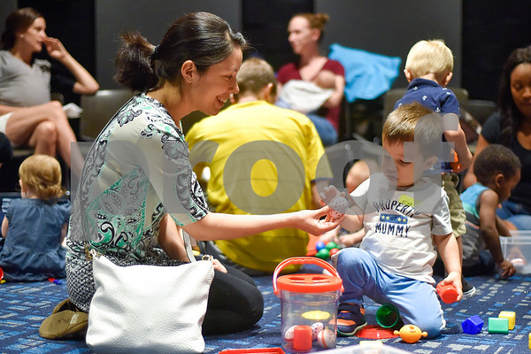 Ana Tarango smiles as she hands Ethan Tarango, 18 months, a toy egg during a toddlers explore class at the Tyler Public Library in Tyler, Texas, on Wednesday, June 21, 2017. The weekly event includes a story time followed by play time with a variety of toys. (Chelsea Purgahn/Tyler Morning Telegraph)