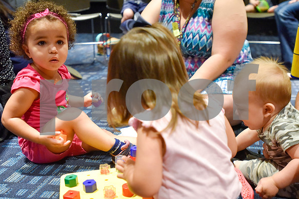 Neriah Hemp, 2, left, plays during a toddlers explore class at the Tyler Public Library in Tyler, Texas, on Wednesday, June 21, 2017. The weekly event includes a story time followed by play time with a variety of toys. (Chelsea Purgahn/Tyler Morning Telegraph)