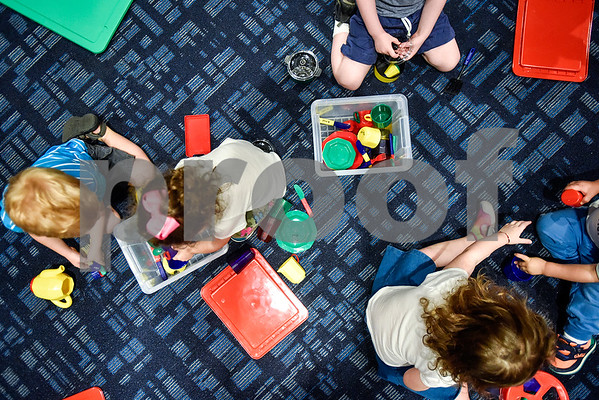 Children play during a toddlers explore class at the Tyler Public Library in Tyler, Texas, on Wednesday, June 21, 2017. The weekly event includes a story time followed by play time with a variety of toys. (Chelsea Purgahn/Tyler Morning Telegraph)