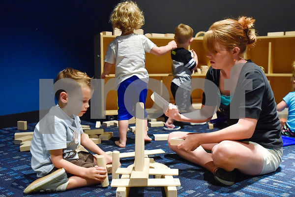 Grayson Manley, 3 1/2, and Tiffany Manley play with blocks during a toddlers explore class at the Tyler Public Library in Tyler, Texas, on Wednesday, June 21, 2017. The weekly event includes a story time followed by play time with a variety of toys. (Chelsea Purgahn/Tyler Morning Telegraph)
