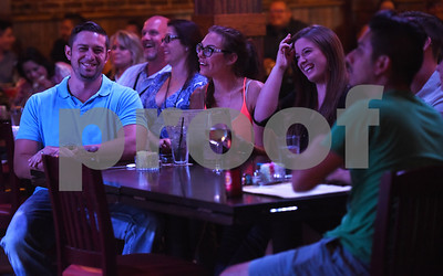 Attendees of the stand-up night at the East Texas Comedy Festival laugh Wednesday night June 22, 2016 at Rick's on the Square.  (Sarah A. Miller/Tyler Morning Telegraph)