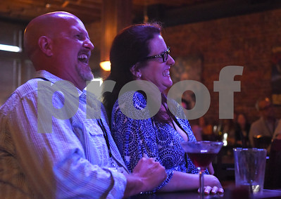 A couple laughs during the stand-up night at the East Texas Comedy Festival Wednesday night June 22, 2016 at Rick's on the Square.  (Sarah A. Miller/Tyler Morning Telegraph)