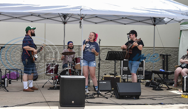 A live band plays at the Gander Outdoor Fest held at Gander Outdoors in Tyler on Saturday, June 22. The event was coordinated by the East Texas Locals group and included food trucks, face painting, paintball, live music and more. (Jessica T. Payne/Tyler Morning Telegraph)