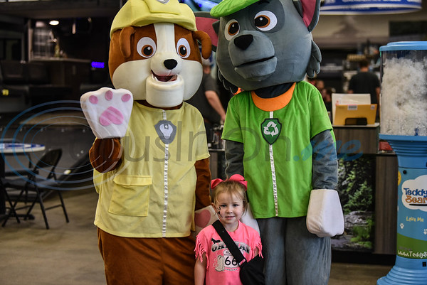 Kyndall Sanders, 3, smiled for a photo with the Paw Patrol at the Gander Outdoor Fest on Saturday, June 22. The event included food trucks, face painting, paintball, live music and more. (Jessica T. Payne/Tyler Morning Telegraph)