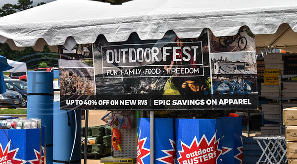 A Gander Outdoor Fest banner hangs from a tent at the event on Saturday, June 22. The event took place at Gander Outdoors in Tyler and help to benefit the Fallen Outdoors. East Tyler Locals coordinated the fest which included food trucks, face painting, paintball, live music and more. (Jessica T. Payne/Tyler Morning Telegraph)