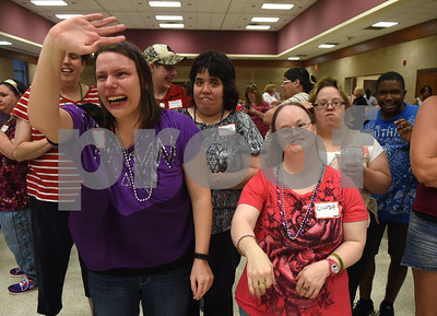 "Ciera Droby waves with Cindy Ray as cast members of the Tyler Civic Theatre's ""The Little Mermaid"" perform a dance at the Fun Lover's Dance for The Arc of Smith County Thursday night June 23, 2016. The Arc is an organization that promotes and protects the human rights of people with intellectual and developmental disabilities and supports their full inclusion and participation in the community. ""The Little Mermaid"" play runs July 28-31 August 4-14.  (Sarah A. Miller/Tyler Morning Telegraph)"