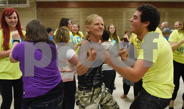 "Lee Myatt dances withTyler Civic Theatre's ""The Little Mermaid"" cast member Chris Fisher at the Fun Lover's Dance for The Arc of Smith County Thursday night June 23, 2016. The Arc is an organization that promotes and protects the human rights of people with intellectual and developmental disabilities and supports their full inclusion and participation in the community. ""The Little Mermaid"" play runs July 28-31 August 4-14.  (Sarah A. Miller/Tyler Morning Telegraph)"