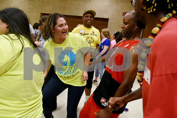 "Nicki Dempsey, a cast member of the Tyler Civic Theatre's ""The Little Mermaid"" dances with Walter Pattee during a surprise flash mob at the Fun Lover's Dance for The Arc of Smith County Thursday night June 23, 2016. The Arc is an organization that promotes and protects the human rights of people with intellectual and developmental disabilities and supports their full inclusion and participation in the community. ""The Little Mermaid"" play runs July 28-31 August 4-14.  (Sarah A. Miller/Tyler Morning Telegraph)"