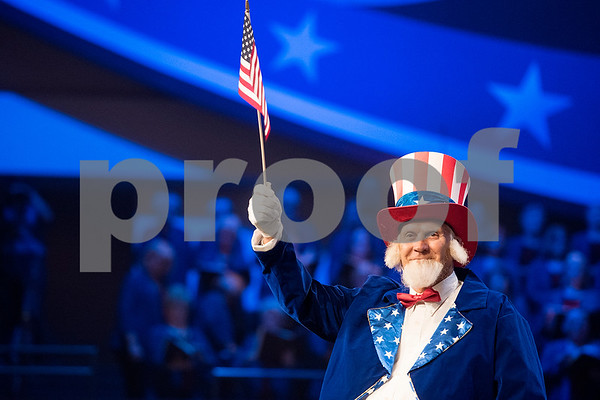 "A man dressed as Uncle Sam waves an American flag during the 27th annual ""I Love America"" program at Green Acres Baptist Church in Tyler, Texas, on Friday, June 23, 2017. The show featured patriotic tunes and Christian worship songs to celebrate Independence Day. (Chelsea Purgahn/Tyler Morning Telegraph)"