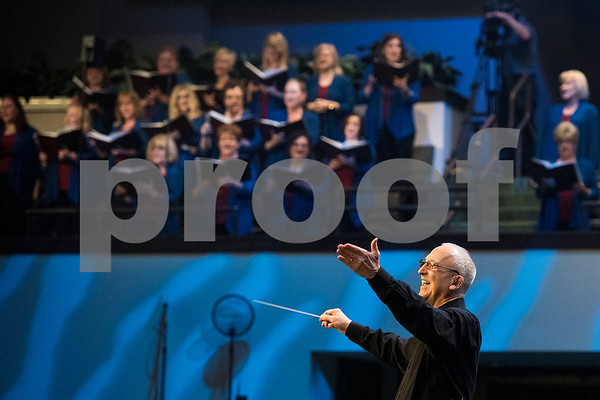 "A conductor leads the audience in song during the 27th annual ""I Love America"" program at Green Acres Baptist Church in Tyler, Texas, on Friday, June 23, 2017. The show featured patriotic tunes and Christian worship songs to celebrate Independence Day. (Chelsea Purgahn/Tyler Morning Telegraph)"