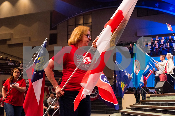 "Church members carry state flags during the 27th annual ""I Love America"" program at Green Acres Baptist Church in Tyler, Texas, on Friday, June 23, 2017. The show featured patriotic tunes and Christian worship songs to celebrate Independence Day. (Chelsea Purgahn/Tyler Morning Telegraph)"