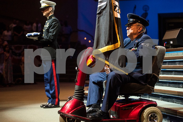 "A soldier holds a flag for the fallen and a veteran holds a flag for MIA/POW during the 27th annual ""I Love America"" program at Green Acres Baptist Church in Tyler, Texas, on Friday, June 23, 2017. The show featured patriotic tunes and Christian worship songs to celebrate Independence Day. (Chelsea Purgahn/Tyler Morning Telegraph)"