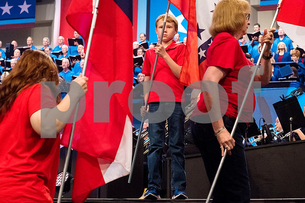 """Church members carry flags from each state during the 27th annual """"I Love America"""" program at Green Acres Baptist Church in Tyler, Texas, on Friday, June 23, 2017. The show featured patriotic tunes and Christian worship songs to celebrate Independence Day. (Chelsea Purgahn/Tyler Morning Telegraph)"""