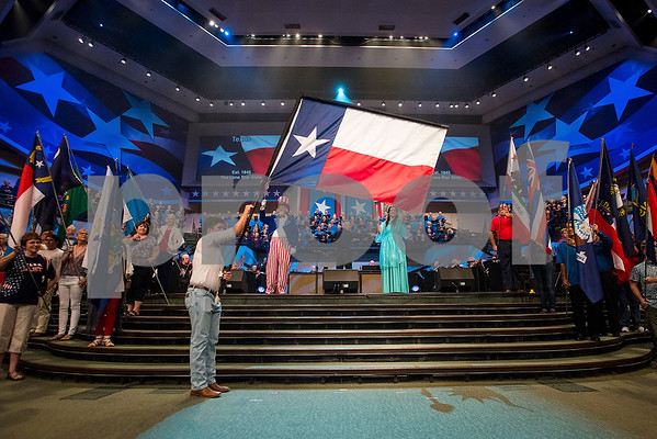"The Texas flag is raised during the 27th annual ""I Love America"" program at Green Acres Baptist Church in Tyler, Texas, on Friday, June 23, 2017. The show featured patriotic tunes and Christian worship songs to celebrate Independence Day. (Chelsea Purgahn/Tyler Morning Telegraph)"