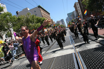 The San Francisco Lesbian/Gay Freedom band entertains the crowd along the parade.  The Theme of this yearÕs Pride Parade was, ÒPride Not Prejudice.Ó   The event, which has been running every year consecutively since 1972 under various names, was expected to reach 1 million attendees this year.  Hundreds of Parade contingents paraded 9 blocks down Market Street from Beale St to 8th street.  Contingents ranged from corporate sponsors, to regional ethnic dance groups and everything in between, all in support of the Gay, Lesbian and Transgender community.  Even SF Mayor Gavin Newsom had his own contingent in the parade as he jogged along shaking hands with people in the public.
