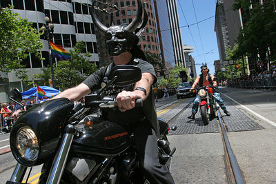 Members of SF Leather Pride ride their motorcycles down Market Street during the Parade.  The Theme of this yearÕs Pride Parade was, ÒPride Not Prejudice.Ó   The event, which has been running every year consecutively since 1972 under various names, was expected to reach 1 million attendees this year.  Hundreds of Parade contingents paraded 9 blocks down Market Street from Beale St to 8th street.  Contingents ranged from corporate sponsors, to regional ethnic dance groups and everything in between, all in support of the Gay, Lesbian and Transgender community.  Even SF Mayor Gavin Newsom had his own contingent in the parade as he jogged along shaking hands with people in the public.