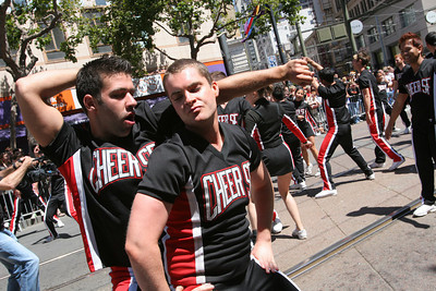 Members of Cheer SF entertain the crowd as they break it down to music along the course of the parade. The Theme of this yearÕs Pride Parade was, ÒPride Not Prejudice.Ó   The event, which has been running every year consecutively since 1972 under various names, was expected to reach 1 million attendees this year.  Hundreds of Parade contingents paraded 9 blocks down Market Street from Beale St to 8th street.  Contingents ranged from corporate sponsors, to regional ethnic dance groups and everything in between, all in support of the Gay, Lesbian and Transgender community.  Even SF Mayor Gavin Newsom had his own contingent in the parade as he jogged along shaking hands with people in the public.
