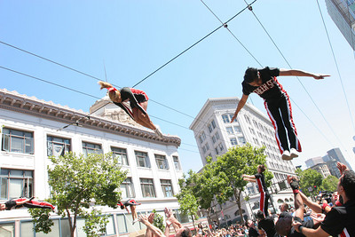 Members of Cheer SF entertain the crowd with their acrobatic moves along the course of the parade. The Theme of this yearÕs Pride Parade was, ÒPride Not Prejudice.Ó   The event, which has been running every year consecutively since 1972 under various names, was expected to reach 1 million attendees this year.  Hundreds of Parade contingents paraded 9 blocks down Market Street from Beale St to 8th street.  Contingents ranged from corporate sponsors, to regional ethnic dance groups and everything in between, all in support of the Gay, Lesbian and Transgender community.  Even SF Mayor Gavin Newsom had his own contingent in the parade as he jogged along shaking hands with people in the public.