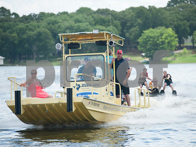 Red Ross drives the custom boat made for sit skiing during the Lake Palestine Adaptive Aquafest Saturday June 25, 2016 in Bullard, Texas. Over 50 adults and children with varying physical and/or mental handicaps had the opportunity to water ski with help from Houston-based Texas Adaptive Aquatics.  (Sarah A. Miller/Tyler Morning Telegraph)