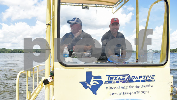 Red Ross and Steve Cosby of Houston-based Texas Adaptive Aquatics drive the custom boat made for sit skiing during the Lake Palestine Adaptive Aquafest Saturday June 25, 2016 in Bullard, Texas.   (Sarah A. Miller/Tyler Morning Telegraph)