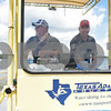 Red Ross and Steve Cosby of Houston-based Texas Adaptive Aquatics drive the custom boat made for sit skiing during the Lake Palestine Adaptive Aquafest Saturday June 25, 2016 in Bullard, Texas. <br /> <br /> (Sarah A. Miller/Tyler Morning Telegraph)