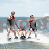 Volunteers George Ward, left, and Brendyn Cosby, right, assist Collin Mullins, 6, of Palestine and his speech therapist Susan Priest as they sit ski during the Lake Palestine Adaptive Aquafest Saturday June 25, 2016 in Bullard, Texas.<br /> <br /> (Sarah A. Miller/Tyler Morning Telegraph)