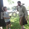 Logan Gallandt, 8, of Palestine, buys a handmade dagger from vendor Ryan Lynch at Tyler Celtic Fest Saturday June 25, 2016 at the Goodman Museum in Tyler.<br /> <br /> (Sarah A. Miller/Tyler Morning Telegraph)