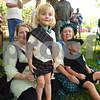 Naomi Vik, Azariah Vik-Moreland, 3, Reba Vik and Erik Jaloma, 3, watch a battle demonstration during Tyler Celtic Fest Saturday June 25, 2016 at the Goodman Museum in Tyler.<br /> <br /> (Sarah A. Miller/Tyler Morning Telegraph)