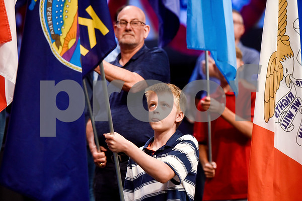 People carry state flags at the I Love America program at Green Acres Baptist Church in Tyler, Texas, on Monday, June 25, 2018. The program featured patriotic tunes and worship songs. (Chelsea Purgahn/Tyler Morning Telegraph)