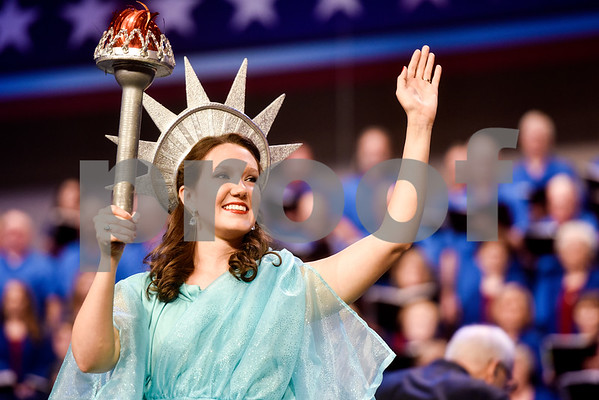 A woman dressed as Lady Liberty waves at the I Love America program at Green Acres Baptist Church in Tyler, Texas, on Monday, June 25, 2018. The program featured patriotic tunes and worship songs. (Chelsea Purgahn/Tyler Morning Telegraph)
