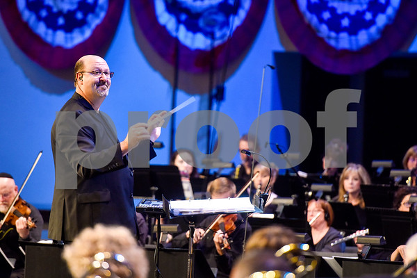 A man conducts during at the I Love America program at Green Acres Baptist Church in Tyler, Texas, on Monday, June 25, 2018. The program featured patriotic tunes and worship songs. (Chelsea Purgahn/Tyler Morning Telegraph)