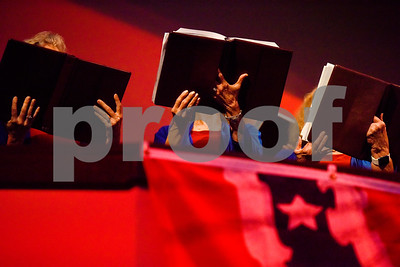 Choir members hold their music folders as they sing at the I Love America program at Green Acres Baptist Church in Tyler, Texas, on Monday, June 25, 2018. The program featured patriotic tunes and worship songs. (Chelsea Purgahn/Tyler Morning Telegraph)