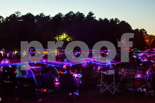 People with glow sticks wait for the fireworks to begin during the family fireworks celebration at South Side Baptist Church in Tyler, Texas, on Friday, June 29, 2018. Thousands of people came out to participate in family activities, enjoy local food and watch the fireworks. (Chelsea Purgahn/Tyler Morning Telegraph)