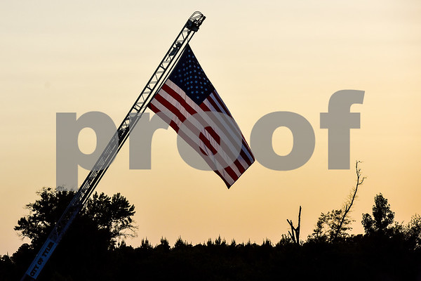 The American flag is displayed from a fire ladder during the family fireworks celebration at South Side Baptist Church in Tyler, Texas, on Friday, June 29, 2018. Thousands of people came out to participate in family activities, enjoy local food and watch the fireworks. (Chelsea Purgahn/Tyler Morning Telegraph)