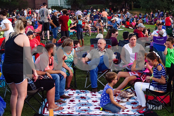 People wait for the fireworks to begin at the family fireworks celebration at South Side Baptist Church in Tyler, Texas, on Friday, June 29, 2018. Thousands of people came out to participate in family activities, enjoy local food and watch the fireworks. (Chelsea Purgahn/Tyler Morning Telegraph)