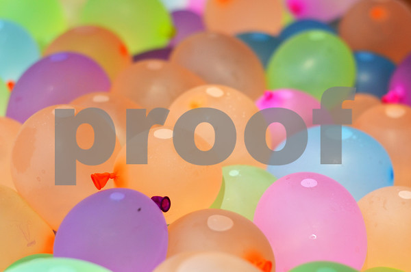 A tub full of multi-colored water balloons awaits the wet massacre that took place at Bergfeld Park. (Victor Texcucano)