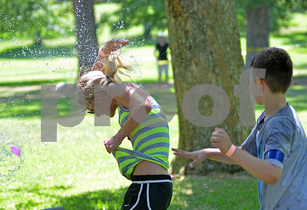 Tylerites spent Sunday afternoon pelting each oher mercilessly with water balloons during a modified game of Capture the Flag. (Victor Texcucano)