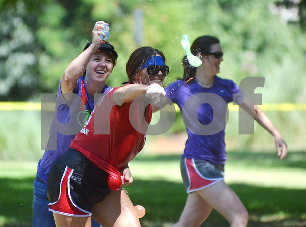 The war commences with the launch of water balloons across Bergfeld Park, in celebration of the Aquapalooza Water Balloon Fight. Funds raised at the event will be donated to local nonprofit organization People Attempting to Help. (Victor Texcucano)