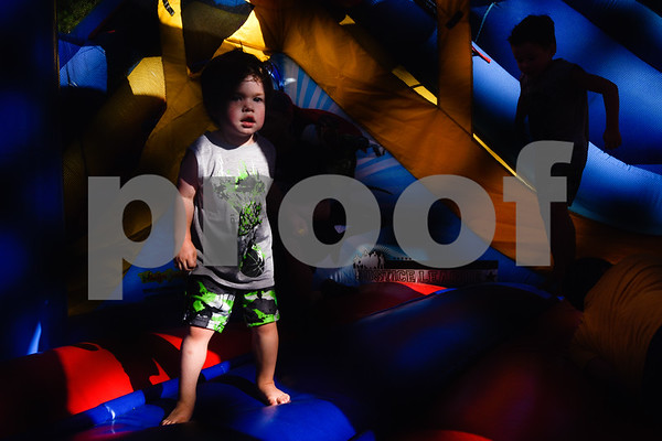Kids jump on a bounce house during the family fireworks celebration at South Spring Baptist Church in Tyler, Texas, on Friday, June 30, 2017. The event featured live music, food trucks, bounce houses and fireworks for families to enjoy. (Chelsea Purgahn/Tyler Morning Telegraph)