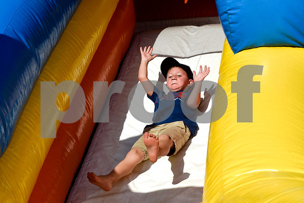 Cameron Dean, 6, slides down an inflatable slide during the family fireworks celebration at South Spring Baptist Church in Tyler, Texas, on Friday, June 30, 2017. The event featured live music, food trucks, bounce houses and fireworks for families to enjoy. (Chelsea Purgahn/Tyler Morning Telegraph)