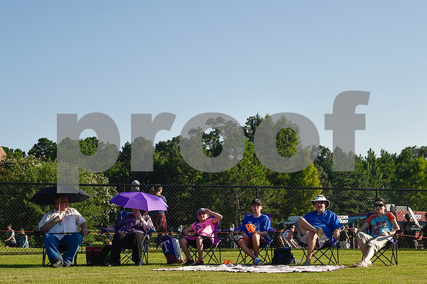 People sit and listen to music during the family fireworks celebration at South Spring Baptist Church in Tyler, Texas, on Friday, June 30, 2017. The event featured live music, food trucks, bounce houses and fireworks for families to enjoy. (Chelsea Purgahn/Tyler Morning Telegraph)
