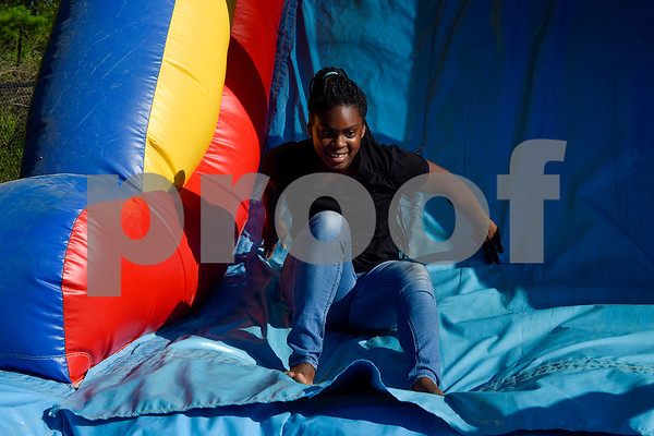 Markesha Allen, 13, slides down an inflatable obstacle course during the family fireworks celebration at South Spring Baptist Church in Tyler, Texas, on Friday, June 30, 2017. The event featured live music, food trucks, bounce houses and fireworks for families to enjoy. (Chelsea Purgahn/Tyler Morning Telegraph)