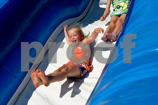 Kendall Tjoelker, 5, smiles as she slides down an inflatable slide during the family fireworks celebration at South Spring Baptist Church in Tyler, Texas, on Friday, June 30, 2017. The event featured live music, food trucks, bounce houses and fireworks for families to enjoy. (Chelsea Purgahn/Tyler Morning Telegraph)