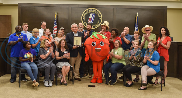City of Jacksonville residents and Jacksonville Chamber of Commerce members applaud as Mayor Randy Gorham announces Jacksonville as Tomatoville for the week of Tomato Fest. The Jacksonville Chamber of Commerce puts on Tomato Fest events starting Saturday, June 1, leading up to the annual Tomato Fest on Saturday, June 8. (Jessica T. Payne/Tyler Morning Telegraph)