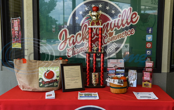 """The framed Proclamation of Jacksonville as Tomatoville for the week of Tomato Fest is displayed on the """"Tomato Table"""" at the Jacksonville Chamber of Commerce. The proclamation was made at Jacksonville City Hall on Monday, June 3 to begin the week long festivities leading up to the Tomato Fest on Saturday, June 8. (Jessica T. Payne/Tyler Morning Telegraph)"""