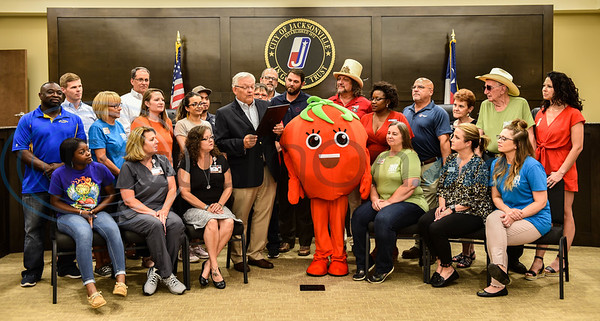 City of Jacksonville residents and Jacksonville Chamber of Commerce members gather on Monday, June 3 as newly elected Mayor Randy Gorham announces Jacksonville to be named Tomatoville during the week of the city's Tomato Fest Celebrations. Jacksonville is known for its famous tomatoes and holds Guinness World Record for making the Largest Bowl of Salsa. (Jessica T. Payne/Tyler Morning Telegraph)