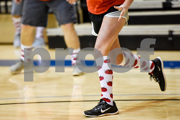 A dodgeball team wears tomato socks during the third annual dodgeball challenge at John Alexander Gym in Jacksonville, Texas, on Monday, June 5, 2017. The dodgeball game kicked off a week of events for the Jacksonville Tomato Festival. (Chelsea Purgahn/Tyler Morning Telegraph)