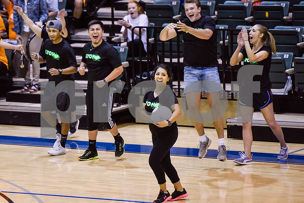 Teammates celebrate as Nelva Rangel, center, caught a ball from the opposing team and thus won the game during the third annual dodgeball challenge at John Alexander Gym in Jacksonville, Texas, on Monday, June 5, 2017. The dodgeball game kicked off a week of events for the Jacksonville Tomato Festival. (Chelsea Purgahn/Tyler Morning Telegraph)